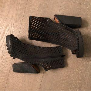 Jeffrey Campbell black caged heels.